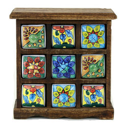 "MarktSq - Ceramic Drawer (9 Drawers) - Rustic hand painted ceramic drawers ideal for storing small jewelry or other trinkets. The drawers are hand painted in different designs and the wooden chest has a rustic distressed finish. Approximate dimensions: L 9.5"" x H 10.5"" x W 4"". The chest has small clips built into it that prevent the drawers from slipping."