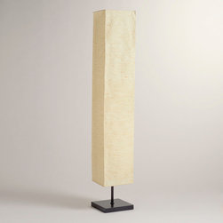 World Market - Kabuki Paper Floor Lamp - Our Kabuki Floor Lamp makes a big statement, standing several feet tall and glowing from within its handmade, taupe-colored paper shade. Placed in a living room or bedroom, its softly filtered illumination adds a lovely spotlight for creating a little drama of your own.