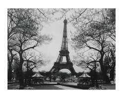Oriental Furniture - Eiffel Tower Park Canvas Wall Art - Classic black and white photograph of the Eiffel Tower with a vintage feel. The landscape print of this iconic landmark includes bare, high-contrasting trees, a winding path, and two festive carousels at the base of the Tower. High grade print is perfect for the office or living room of a world traveler or just a lover of all things French.