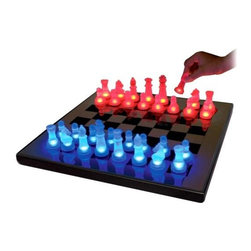 Lumisource - LED Glow Chess Set in Blue/Red - Add a touch of magic to your next game of chess with this unique set, featuring game pieces in blue and red with LED lights that illuminate when they are near the chess board. Perfect for chess enthusiasts of all ages, the board is battery operated or can be used with a power adapter, which is included with the set. These LED Chess sets are truly unique. The chess pieces light up with no batteries when they are on or near the board. Chess board includes a power adaptor or you can use 4 AA batteries (not included). Blue/Red finish. 15.7 in. W x 15.7 in. L x 1 in. H