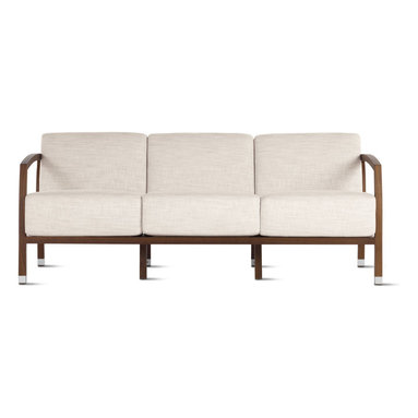 Malena Sofa in Basket Weave - A reflection of Jon Gasca's diverse expertise in industrial engineering, design and photography, his Malena Sofa (2002) boasts precision, character and detail that stand out from every angle. Malena provides excellent lumbar support with its sweeping back legs and gracefully curved rear frame. Featuring a ladder-style back design, this sofa weighs less than similarly sized pieces, allowing much easier positioning than expected. Seat and back cushions follow the frame contours and are clad in soft, durable covers that remove for easy cleaning. Aluminum trim dresses all legs. Design Within Reach is proud to be the exclusive retailer of Stua products in the U.S. Made in Spain.