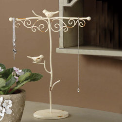 "Songbird Jewelry Tree - The Songbird Jewelry Tree is unlike any tree in your backyard. This one-of-a-kind piece is as useful as it is attractive. The top arms accommodate even your longest baubles, and the lowest branches make a handy place to store rings. Designers finished this piece in antiqued cream and perched whimsical songbirds on the branches. This little tree is both practical and gorgeous! Dimensions: 13"" high"