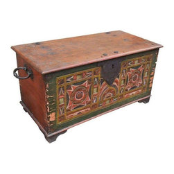 Decorated Antique Trunk - Add some folky flair to your space with this decorative antique trunk. It features a colorful front with elaborate carvings, rustic well-weathered top and sides, and and iron handles and accents.