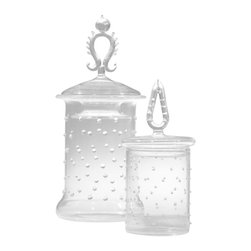 LaBoheme Apothecary Jars Dots - Set of 2 - Intricate glass sprig motifs forming the three-dimensional openwork knobs make the LaBoheme Apothecary Jars instantly noticeable and utterly unique. The cylindrical glass jars, dimpled by regularly-spaced dots of applied glass beading for an upscale yet playful transitional look, are offered in a set of two coordinating lidded containers, each with a different expressive detail on the lid.