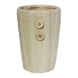 Chesapeake Bay 10⅗-Ounch Sprinkles & Frosting Candle & Sweater Candleholder - I'd love this sweater-print candle in my entryway.
