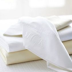 """700-Thread-Count Sheet Set, Cal. King, Ivory - Sateen woven of cotton to an unrivaled 700-thread count, our sheet set brings unparalleled softness and comfort to the bed. A double pin-tuck hem borders the pillowcases and flat sheet. Pure cotton sateen. 700-thread count. Set includes flat sheet, fitted sheet and 2 pillowcases (1 with twin set). Available in white or ivory. Machine wash. Catalog / Internet only. Imported. Monogramming is available at an additional charge. Monogram is 3"""" and will be centered along the border of the pillowcase and the flat sheet."""