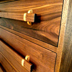 Walnut Dressers--dovetailed carcase - Custom made walnut bureaus with unique wooden pulls.