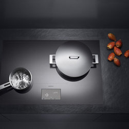 Gaggenau - Gaggenau Induction Cooktop - Gaggenau exhibited an innovative, new cooktop at the LivingKitchen show in Germany in January 2011.  It's a new generation induction cooktop with a phenomenal feature.  Anywhere you slide your pot or pan on its surface will work as a burner.  It will even move your temperature setting from its previous location.  I've been told it will be available in the US mid-2012.