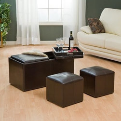 Jameson Double Storage Ottoman with Tray Tables - Think of the Jameson Double Storage Ottoman as the MacGyver of living room furniture. With so many uses this double storage ottoman is packed with plenty of secrets. It's a rectangular double-storage ottoman with two small square ottomans inside. All three ottomans feature faux leather upholstery with attractive contrast stitching. Underneath the two cushioned lids you'll discover two handy serving tray tables for drinks and snacks. You can easily use these trays as small coffee tables or lap trays while watching TV. Best of all you still have two more ottomans for your feet as you use the trays. While the small ottomans are great for extra seating the large ottoman is designed for generous storage. Tuck all your family room essentials - pillows throws magazines - inside to cut down on clutter and give you more space to relax. Available in black or brown this ottoman set will provide a comfortable resting place and a practical storage space to keep your living room tidy. Dimensions: Double ottoman: 36W x 18D x 18H inches 2 inside ottomans: 14W x 14D x 14.5H inches Storage area: 31.5L x 14.5W x 12H inches