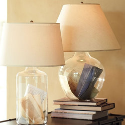 Bacchus Glass Table & Bedside Lamp - These clear lamps can be filled with anything your heart desires (think shells, love notes, marbles), but there's also something to be said for keeping them empty in honor of their sweet, simple design.Price varies by size from $169 to $199.