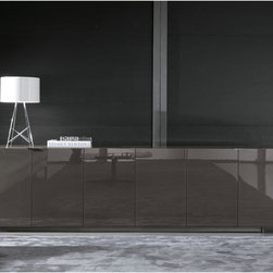 Minotti - Minotti Harvey Line High Console - A transformation rather than an evolution. New Lacquered color, new performances, and new sizes. These consoles are available with all doors, all drawers, or a combination of both. For the base, wood has been followed by metal in a pewter finish, simple and linear. Finishes include a glossy lacquer or open-pore lacquered oak. Three lengths available and units are available in a variety of drawer and door combinations. Price includes shipping to the USA. Manufactured by Minotti.