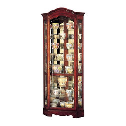 "Howard Miller - Jamestown Crystl-Cut Glass Curio Cabinet in W - Exhibit those fine cognac and shot glasses, heirlooms and other treasures in your enchantingly constructed Curio w Curved Pediment, Grooved Glass Doors & Windsor Cherry Finish, a mesmerizing piece accentuated with platinum finish and extraordinary design. * Crystal-cut grooved glass on the door follows the curves of the pedimentFinished in Windsor Cherry on select hardwoods and veneersHalogen lighting for brighter, whiter, longer-lasting light to illuminate your collectiblesAdjustable levelers under each corner provide stability on uneven and carpeted floorsCabinet is illuminated by an interior lightLocking door for added securityEight levels of display space accommodate your many treasuresGlass shelves can be adjusted to any level within your cabinetNo-ReachT light switch is conveniently located on the back of the cabinetPad-LockT cushioned metal shelf clips increase stability and safety82-1/4""H x 34""W x 21""D"