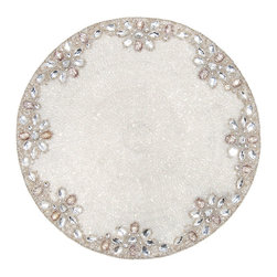 Crystal/Silver Jaipur Placemat - A placemat that sparkles as if illumed by moondrops just fallen from a silvery sky. The Crystal/Silver Jaipur Placemat boasts a simple round shape accentuated with a glimmering rim of silver beading. Owing to its neutral coloration, the placemat blends harmoniously with either bold or subdued tablescapes.