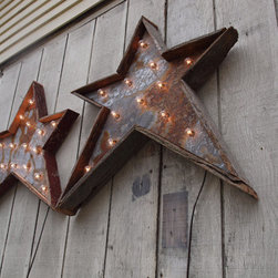 Christmas Star Light Fixture by West Vintage Trading Company - Rustic style blends remarkably well with industrial, and these metal stars are here to prove it.