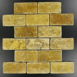 "Gold and Yellow Tumbled Mesh-Mounted Travertine Mosaic Tiles 2"" x 4"" - 2"" x 4""Gold / Yellow Mesh-Mounted Travertine Mosaic Tile is a great way to enhance your decor with a traditional aesthetic touch. This Tumbled Mosaic Tile is constructed from durable, impervious Travertine material, comes in a smooth, unglazed finish and is suitable for installation on floors, walls and countertops in commercial and residential spaces such as bathrooms and kitchens."