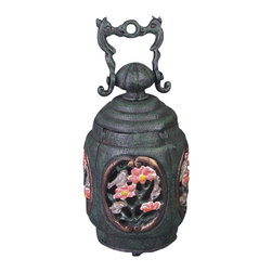 AA Importing - Cast Iron Tealight Candle Holder with Bird an - A painted bird and flower motif accents this hanging tealight candle holder, a perfect accent on a deck or patio. The oval shaped candle holder is constructed of cast iron and features open detailing to allow the candle's flames to cast light. It stands 7.5 inches tall. Bird and floral design. Cast iron. 4 in. Dia. x 7.5 in. H