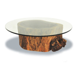Hollow Trunk Coffee Table - Round Glass Top - Coffee table base made of a hollow trunk from a tree that died naturally. It is the result of a natural process, which sometimes is started by a fungi or insect intrusion through a broken branch. After being attacked, a tree may still live for many years, even decades, until it becomes completely hollowed out inside. One-of-a-kind item.