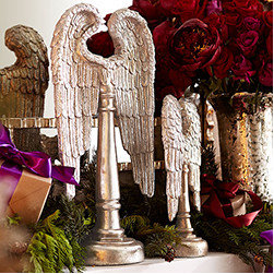Angel Wings - Set of 2 - New - We love this abstract take on angels. Take it as a homage to It's a Wonderful Life—a reminder to appreciate where you are, and to take extra care to perform a good deed this holiday season. Place this statue anywhere you need to add height in your existing décor. We love it perched on a buffet. The set is crafted from resin to reduce weight; you can put them almost anywhere.