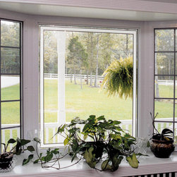 Bay Windows - This bay window features casement vents with Colonial grids.