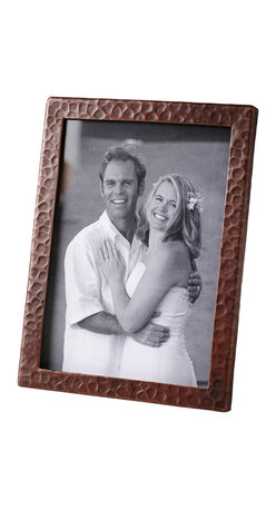 Native Trails - Copper Picture Frame - Photo op! When it comes to framing priceless pics, you want the frame to be worthy of the photo it holds. This one fits the bill. And, it's made of recycled copper, so it's eco friendly too. Each is hammered by hand for one-of-a-kind character.