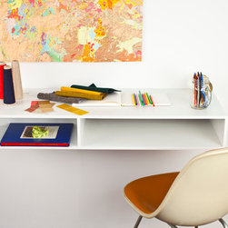 The Cutter - The Cutter is a multi purpose wall mounted storage unit and workstation. The cord routing slot eliminates clutter on the desktop. The Cutter is made from solid Corian with a plywood back. The non-porous surface is easy to clean and maintain.