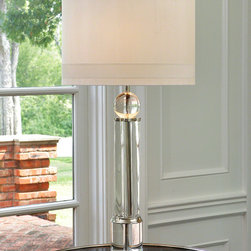 Crystal Column Lamp - An impressive piece of over three feet high, the Crystal Column Lamp presents gleaming forms in a harmonious combination.  Its base is a sleek upright cylinder of clear crystal, while a sphere joins its column to the ivory silk drum shade.  Light color and formal design presides over your d�cor for a glamorous, thoughtful experience of your visual world.