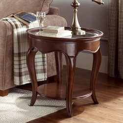 """American Drew Cherry Grove The New Generation Oval End Table with Wood Top - Get your oval on with the American Drew Cherry Grove The New Generation Oval End Table with Wood Top. This durable end table is crafted of high-quality engineered wood, finished in an exquisite mid-tone brown finish, and outfitted with a display shelf.About American DrewFounded in 1927, American Drew is a well-established, leading manufacturer of medium- to upper-medium-priced bedroom, dining room, and occasional furniture. American Drew's product collections cover a broad variety of style categories including traditional, transitional, and contemporary. Their collections range from the legendary 18th-century traditional """"""""Cherry Grove,"""""""" celebrating its 42nd year of success, to the extremely popular """"""""Bob Mackie Home Collection,"""""""" influenced by the world-renowned fashion designer Bob Mackie. """"""""Jessica McClintock Home"""""""" features another beloved designer bringing unique style to an American Drew line. American Drew's headquarters are located in Greensboro, N.C. Their products are distributed through thousands of independently owned retailers throughout the United States and Canada and around the world."""