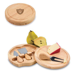 "Picnic Time - Oakland Raiders Brie Cheese Board Set in Natural Wood - The Brie cheese board set is the perfect sized accessory for a small party or get-together. The board is a 7.5"" swivel-style, split level circular cutting board made or eco-friendly rubberwood that swings open to reveal the cheese tools housed under the board. The three stainless steel cheese tools have rubberwood handles. Tools included are a hard cheese knife, a chisel knife (hard crumbly cheese), and a cheese fork. A carved moat surrounds the perimeter of the board which helps to prevent brine or juice run-off. The Brie makes a delightful gift.; Decoration: Engraved; Includes: 3 Stainless steel cheese utensils (1 hard cheese knife, a chisel knife (hard crumbly cheese), and cheese fork) with wooden handles"