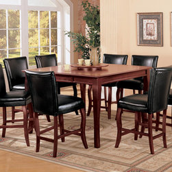 9 PC Cherry Wood Counter Dining Set Lazy Susan Chairs Leather Seat - This elegant counter height dining table will add an updated look to your dining and entertainment space. The generously sized square wooden table top has a sleek molded edge, with a lazy Susan included to make sharing snacks and condiments a cinch around this gathering table. Shapely wooden legs complete the look, in a warm cherry wood finish that is sure to complement your decor. Pair with the matching counter height stools for a fun and stylish area in your home that friends and family will truly enjoy.