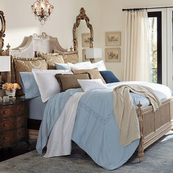 """Frontgate - Cordoba Euro Sham - Lavish piecings and trimmings embellish this visually rich collection. Coordinates beautifully with our solid Resort Bedding Collection. Personalize the ensemble with an embroidered monogram pillow.. Euro Sham has grosgrain border with antiqued brass button accents. Pleated bed skirt has an 18"""" drop and 3"""" decking border. Inspired by old-world tapestries, Cordoba brings a touch of its soft tradition to your decor. Both light and masculine, its paisleys and houndstooth are interwoven with mocha and spa blue tones; decorative pillows and accessories are embellished with subtle trim and button detailing.  .  .  .  .  . Box Spring Cover has elastic on all four sides for a secure fit . All shams and pillows include a high-quality down pillow insert . Bedskirt, Euro Sham, and Corded Decorative Pillow are woven of 75% cotton and 25% polyester . Hound's-tooth Decorative Pillow is 62% polyester, 26% rayon, and 12% cotton . Mohair Decorative Pillow is 100% wool mohair . Each collection is specially made to order; please allow 4-6 weeks for delivery . Dry clean . Made in the USA of imported fabrics."""
