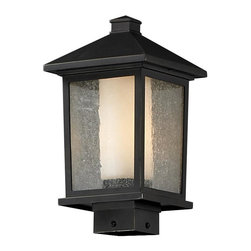 One Light Oil Rubbed Bronze Seedy + Matte Opal Glass Post Light - Unique double glass styling and rectangular detailing define the modern styling of this medium outdoor post head. Seedy glass on the outside with matte opal inner glass creates an elegant glow, while the cast aluminum hardware finished in oil rubbed bronze can withstand nature's seasonal elements.