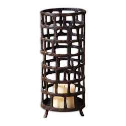 "Uttermost - Arig Distressed Candleholder - Hand Forged Metal Finished In Distressed, Aged Black With Rust Brown Undertones. Beige Candle Included.; Collection: Arig; Designer: Matthew Williams; Material: Metal; Finish: Distressed, Aged Black With Rust Brown Undertones.; Dimensions: 6""D x 6""W x 14.5""H; Uttermost's Candleholders Combine Premium Quality Materials With Unique High-style Design.; With The Advanced Product Engineering And Packaging Reinforcement, Uttermost Maintains Some Of The Lowest Damage Rates In The Industry. Each Product Is Designed, Manufacturered And Packaged With Shipping In Mind."