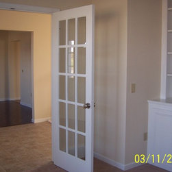 Interior French Doors - Another set of french doors that are interior. These doors are separating the dining room from the entertainment room. With the doors open, you can inter-mix the two rooms for great entertaining during the holidays.