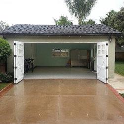 Carriage Garage Door in a Bi Fold configuration East Side Costa Mesa Home Office - Ziegler Doors, Inc.