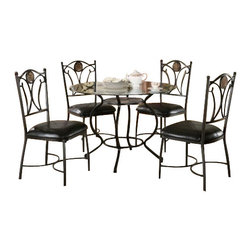 "Coaster - 5 Pc Set (Dark Metal) By Coaster - Includes table and four side chairs. Casual style. Round shaped table. Beveled glass table top. curvaceous pedestal base. Metal side chair. Leather-like upholstered seat. Decorative ornaments on seat back. Straight legs. Made from metal and glass. Darla metal color. Table: 42. "" Dia. x 30 "" H. Chair: 20.5 "" W x 19.5 "" D x 38 "" H.  Enhance your casual dining space or breakfast nook with the simple elegance of this five piece dining set. This glass table and chair set will make a wonderful addition to your home and create an inviting dining atmosphere for family and guests."