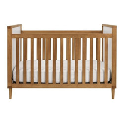 Skip 3-in-1 Convertible Crib With Toddler Rail - For a more modern take, this midcentury modern crib is a great choice. Clean lines and warm wood are perfect for either gender.