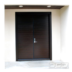 Los Angeles Custom Modern Garage Doors & Matching Entry Door System Project - Los Angeles, CA - Looking for a stunning contemporary entry door that will make heads turn?  Dynamic Garage Door designs, crafts and installs contemporary style entry door systems that convey beauty, elegance and architectural style!