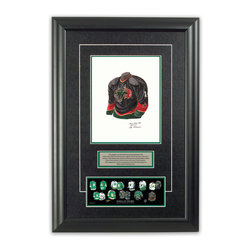 """Heritage Sports Art - Original art of the NHL 2005-06 Dallas Stars jersey - This beautifully framed piece features an original piece of watercolor artwork glass-framed in an attractive two inch wide black resin frame with a double mat. The outer dimensions of the framed piece are approximately 17"""" wide x 24.5"""" high, although the exact size will vary according to the size of the original piece of art. At the core of the framed piece is the actual piece of original artwork as painted by the artist on textured 100% rag, water-marked watercolor paper. In many cases the original artwork has handwritten notes in pencil from the artist. Simply put, this is beautiful, one-of-a-kind artwork. The outer mat is a rich textured black acid-free mat with a decorative inset white v-groove, while the inner mat is a complimentary colored acid-free mat reflecting one of the team's primary colors. The image of this framed piece shows the mat color that we use (Hunter Green). Beneath the artwork is a silver plate with black text describing the original artwork. The text for this piece will read: This original, one-of-a-kind watercolor painting of the 2005-06 Dallas Stars jersey is the original artwork that was used in the creation of this Dallas Stars uniform evolution print and tens of thousands of other Dallas Stars products that have been sold across North America. This original piece of art was painted by artist Nola McConnan for Maple Leaf Productions Ltd. Beneath the silver plate is a 3"""" x 9"""" reproduction of a well known, best-selling print that celebrates the history of the team. The print beautifully illustrates the chronological evolution of the team's uniform and shows you how the original art was used in the creation of this print. If you look closely, you will see that the print features the actual artwork being offered for sale. The piece is framed with an extremely high quality framing glass. We have used this glass style for many years with excellent results. We package e"""