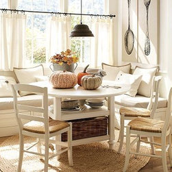 "Shayne Dining Table & Isabella Chair Set, Antique White - Our versatile Shayne Kitchen Table features two leaves that expand its length to 54"" when raised. The table converts back to a demilune or rectangular console by dropping down one or both leaves. Set includes Shayne Kitchen Table and four Isabella Chairs. Table: 49"" wide x 26"" deep x 30 high (with leaves down); expands to 54"" when two leaves raised, and seats up to 4. Chairs (4): 16.5"" wide x 20"" deep x 35.25"" high Table is expertly crafted from select hardwoods and veneers, with solid hardwood legs, turned feet and supporting brackets. Chairs are expertly crafted of solid hardwood. Rush seats are woven of natural rye. Detailed with a hand-rubbed finish with light distressing around the edges. Wood swatches, below, are available for $25 each. We will provide a merchandise refund for wood swatches if they're returned within 30 days. Catalog / Internet Only. View our {{link path='pages/popups/fb-dining.html' class='popup' width='480' height='300'}}Furniture Brochure{{/link}}."