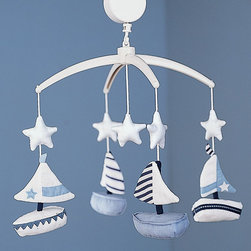 Chase Sailboat Mobile - Guided by the stars, four seaworthy boats sail merrily over the crib.