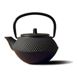 "Matte Black Cast Iron ""Tokyo""  Teapot, 11 Oz. - Unity® Cast Iron ""Tokyo"" Teapot – Matte Black finish.  An elegant, distinctly shaped  cast iron Tetsubin teapot named after the beautiful and ancient city of Tokyo, Japan.  Inspired by highly prized antique Japanese cast iron teapots still in use today. Features a black porcelain enamel interior coating that helps prevent rust Includes a stainless steel tea brewing basket for ease of preparation for brewing and serving tea. Not intended for stovetop use. 11 oz. capacity. Hand Wash"