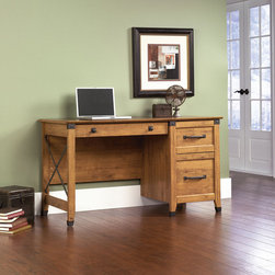 Sauder - Registry Row Computer Desk - Never out of place, the casual design of Registry Row is inspired by the movement to rework and repurpose heritage materials from Industrial Age America. The warm Amber Pine finish recreates the singular character and color of recovered native timber. Riveted Iron finish accents and matching hardware complete the illusion of engineering artfully remade into beautiful and functional furniture. Features: -Desk.-Three drawers with metal runners and safety stops.-Lower drawer holds letter-size hanging files.-Patented T-slot drawer system.-Made in USA.-Wrought iron style hardware and accents.-Registry Row collection.-Desk Type: Computer Desk.-Top Finish: Amber Pine.-Base Finish: Amber Pine.-Accent Finish: Wrought Iron.-Powder Coated Finish: No.-Gloss Finish: No.-UV Finish: No.-Top Material: Engineered wood.-Base Material: Engineered wood.-Hardware Material: Metal.-Edge Detail: Molding.-Non-Toxic: Yes.-Water Resistant: No.-Stain Resistant: Yes.-Heat Resistant: Yes.-Style: Country.-Design: Rectangular.-Hardware Finish: Wrought iron.-Distressed: No.-Collection: Registry Row.-Eco-Friendly: Yes.-Cable Management: Yes.-Keyboard Tray: No.-Height Adjustable: No.-Drawers Included: Yes -Number of Drawers: 3.-File Drawer: Yes.-Drawer Glide Material : Metal runners with safety stops.-Safety Stop : Yes.-Soft-Close Drawer: Yes.-Locking Drawer: No.-Ball Bearing Glides: Yes.-Joinery Type : Hidden cam, dowel, screws.-Drawer Handle Design: Pull and knob..-Pencil Drawer: Yes.-Jewelry Tray: No.-Exterior Shelving: No.-Cabinets Included: No.-Ergonomic Design: No.-Handedness: both.-Scratch Resistant: Yes.-Chair Included: No.-Legs Included: Yes -Number of Legs: 5.-Leg Material: Engineered Wood with wrought iron accents.-Leg Glides: Yes..-Casters Included: No.-Hutch Included: No.-Treadmill Included: No.-Cork Back Panel: No.-Modesty Panel: Yes -Modesty Panel Details: 3/4..-CPU Storage: No.-Built In Outlet: No.-Built In Surge Protector: No.-Light Included: No.