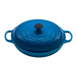 Le Creuset - Le Creuset Signature Enameled Cast Iron Braiser - Braising uses both wet and dry heats to break down tough cuts of meat and tenderize fresh vegetables. The braiser is the perfect family size, whether used for a hearty pork stew or side dish of jasmine rice. This updated kitchen classic enhances the cooking process by evenly distributing heat and locking in the optimal amount of moisture. With ergonomic handles and an advanced interior enamel that resists chipping and cleans easily, Le Creuset's braisers blend the best of the past with the latest innovations in comfort and functionality.