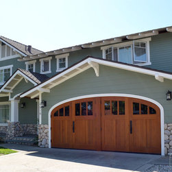 Elliptical Wood Carriage Garage Doors - These elliptical arched outswing garage doors make this house really stand out.