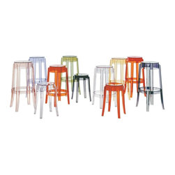 Kartell - Charles Ghost Stool, Set of 2, 18 in., Transparent Orange - Sidle up and sip your martini in high style with this distinctive stool. Its rounded, slightly upturned legs are characteristic of the classic high stools of the 19th century, but its translucent design makes it the cool stool of today. Produced from a single block of transparent polycarbonate, it's highly durable, so you can use it indoors or out.