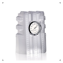 Lalique - Lalique New York Clock Clear - Lalique New York Clock Clear 10119200  -  Size: 3.31 Inches Long x 4.45 Inches Tall  -  Genuine Lalique Crystal  -  Fully Authorized U.S. Lalique Crystal Dealer  -  Created by the Lost Wax Technique  -  No Two Lalique Pieces Are Exactly the Same  -  Brand New in the Original Lalique Box  -  Every Lalique Piece is Signed by Hand, a Sign of its Authenticity and Quality  -  Created in Wingen on Moder-France  -  Lalique Crystal UPC Number: 0090592968116
