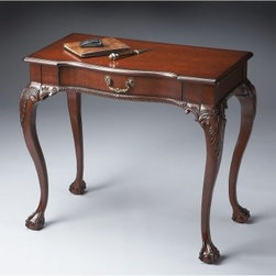 Butler Writing Desk - Plantation Cherry - Crafted of selected hardwoods and choice veneers, the Butler Writing Desk - Plantation Cherry is a great addition to any home. The matched cherry veneer drop front writing surface and drawer fronts offer excellent style, as do the hand carved details. Four exterior and seven interior drawers offer function, and the brass-plated hardware offers additional ornamentation. Also features a lighted interior.About Butler SpecialtyButler Specialty Company has been designing and manufacturing high-quality occasional and accent furniture since 1930. Each piece reflects Butler's dedication to enduring design, exquisite craftsmanship, and top-quality materials. This family-owned company is based in Chicago. They scour the globe in search of the finest materials and most efficient means of production, reflecting their commitment to providing excellent quality at exceptional value.