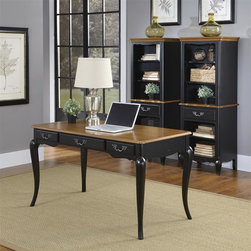 HomeStyles - Oak and Rubbed Black Executive Desk - Includes desk. The Executive Desk is constructed of poplar solids, engineered wood and oak veneers in a distressed oak and heavily rubbed black finish. The distressed oak features several distressing techniques such as worm holes, fly specking, and small indentations. Features include three storage drawers (one being a drop down keyboard tray). Design features include shaped carved proud legs, corner peg accents, and detailed brass hardware. Assembly required. 54 in. W x 28 in. D x 30 in. H