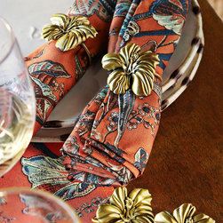Frontgate - Hibiscus Set of Four Napkin Rings - From Tommy Bahama. Made of metal with a brass finish. Clean with a soft, dry cloth. Lend an island feel to your summer soiree with our Hibiscus Napkin Rings. The beautifully dimensional hibiscus bloom is set off with a high-shine brass finish.  .  . .