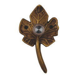 Waterwood - Brass Small Leaf Doorbell in Antique Brass - The Waterwood Small Leaf doorbell is reminiscent of an Autumn fallen leaf. Displaying this doorbell will help you project a spirit of the natural world from the front door of your home. This solid brass doorbell is crafted using the sand casting technique. It is then hand finished and coated with a protective laquer to withstand the elements. Waterwood doorbells are easy to install and will add personality to your home. It comes with a lighted push button and mounting screws.